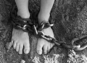 Feet with chains around them